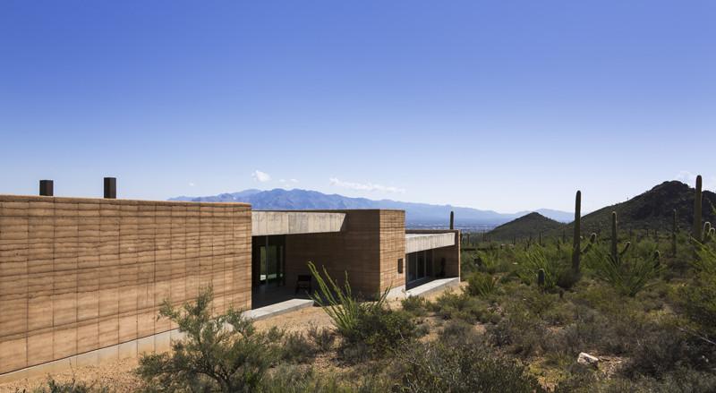 生长的夯土墙:融合自然、建筑